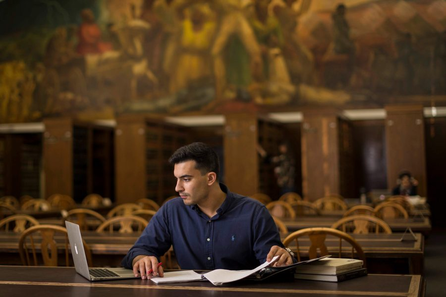 Student studying in law library.