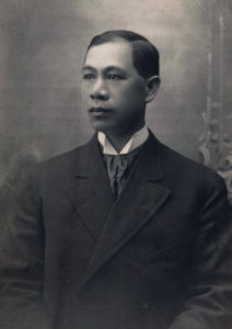 Photo of Hong Yen Chang in black and white, wearing a black suit.