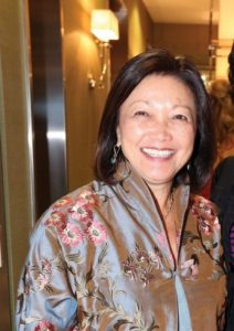 Photo of Patricia A. Yim Cowett, wearing a floral Chinese blouse.